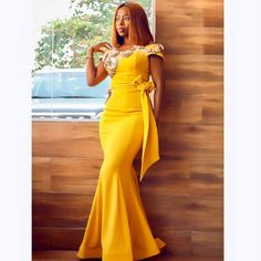 Perfect for a dressy wedding, this mother of the bride dress has a sequined lace bodice and a dramatic mikado skirt punctuated by a ladylike sash. Lace Gown Styles, Ankara Long Gown Styles, Ankara Styles, Prom Party Dresses, Bridesmaid Dresses, Dress Party, Long Gown Elegant, African Fashion, African Men