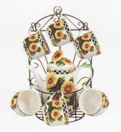 SUNFLOWER 9pc TEA Set Pot & Cups w/Iron Rack NEW! . $42.88. Useful and stylish all in one!. Create a personal and elegant touch to your kitchen!. Perfect for ANY sunflower collector!. Great as a gift!. Excellent attention to detail and such vibrant colors!. Take a look at this BRAND NEW and very beautiful Sunflower Tea Set with Iron Rack. This is truly a gorgeous set with a beautiful design! Each piece has very very nice, detailed, and vibrantly colored Sunflowers.   The...