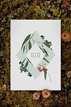 Stunning native botanical Wedding Invitation by Sail and Swan Studio. The design features a pale green diamond shapes with hanging eucalyptus leaves, native greenery and flowers.