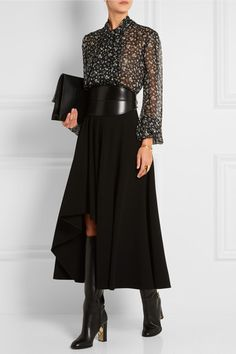 Alexander McQueen floral-print silk-chiffon blouse worn with a major wide black leather belt and a black high-low maxi skirt (midi in front) with knee-high boots!