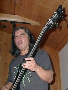 This is John Avila from Oingo Boingo, Food For Feet, Mutaytor, among others. Another huge influence on my playing from an early age, he is a really nice guy in person and I've been fortunate to meet him a few times. Oingo Boingo, Danny Elfman, Man Party, Dead Man, Music Is Life, A Good Man, Really Cool Stuff, Mystic, Bass