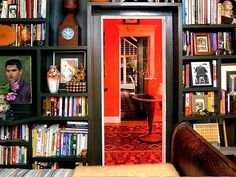 Be a collector and a small space dweller with floor-to-ceiling bookshelves, like the ones designer Luis Caicedo created for this book lover's bedroom. Different sized alcoves create visual interest and fit the need for larger and smaller books without wasting any space.