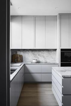 Mim Design won Sub-Zero and Wolf's Kitchen Design Contest, placing first place in the Transitional Kitchen category for this sleek, heritage-meets-contemporary design.