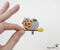 Gryffindor cat Harry Potter Pusheen brooch Pusheen pin Kawaii cat brooch Hogwarts cat Harry Potter jewelry Cat lover gift Cat on broom WELCOME! Find all my brooches here: http://etsy.me/2gNEsVT Up for sell funny Gryffindor pusheen brooch made of polymer clay (: Everyone loves