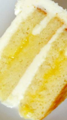 Triple Lemon Cake - The lemon curd is so sweet and perfectly tangy, the buttercream is so light and sweet, yet still with just enough tang and the cake is nicely dense and delicious. #cake, #lemoncake.