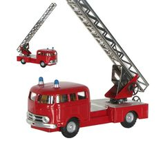 A classic tin plate Mercedes MB355 Fire Engine with fully adjustable telescopic ladder. Made in the Czech Republic by renowned toy makers Kovap. Comes in a beutifully illustrated gift box.    Scale 1:43  Not suitable for children under 3 years old.