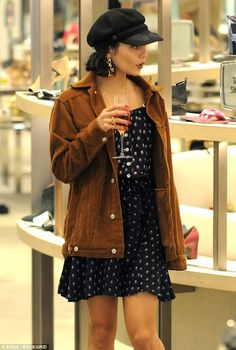 Pinkys up: Vanessa Hudgens, 28, sipped champagne while shopping for new accessories in Los...