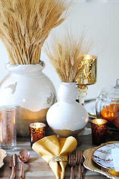 Create a warm and welcoming tablescape with some metallic accessories. Wheat stalks, silverware, plates and Moroccan inspired glasses are from @HomeGoods. (sponsor)