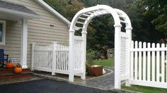 White vinyl scalloped picket fence and double arbor