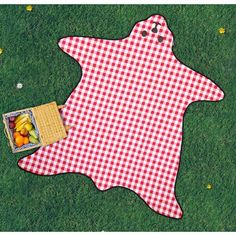 Bear Skin Picnic Blanket. This bear shaped, classic red & white checker pattern has a waterproof backing. No bears were harmed in the making of this picnic blanket. A luxurious gift for lounging in the park like royalty.