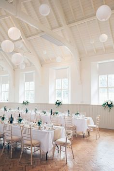 White Hanging Paper Lanterns | DIY Village Hall Wedding | High Street Fashion | Budget Wedding | Anne Schwarz Photography | http://www.rockmywedding.co.uk/clare-chris/