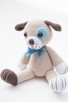 This big lovable puppy is a cute friend for little girls or boys. Made with soft woollen yarn he is superb for cuddling. Hehas big paws, cute eye patch and sweet freckles on his muzzle.A dream toy for any toddler!
