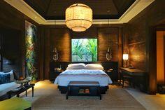 Villa bedroom in the evening at Mandapa, A Ritz-Carlton Reserve Ubud.