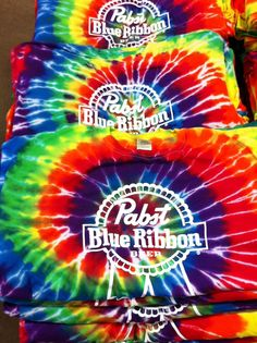 Yes, we can print on Tie Dye shirts!  Here is a colorful shot of some for a client.  www.visualimp.com