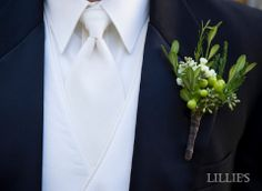 green boutonniere with boxwood, seeded eucalyptus and hypericum berry
