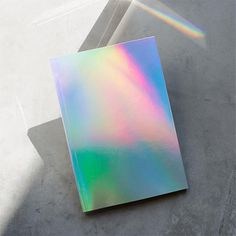 With a mesmerizing holographic finish, this lined notebook is perfect for notes, doodles and anything else you'd like to fill it with. 128 lined pages Materials: Environmentally friendly tree-free paper Size: x School Suplies, Footer Design, Cool School Supplies, Wall Planner, Cool Notebooks, Journals, Milk Shop, Lined Notebook, Shopping