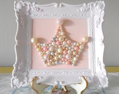 Nothing says Princess like pearls! This adorable pearly crown decor is a simple DIY, and the embellished white frame makes the piece look expensive and eye-catching.