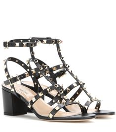 Valentino - Valentino Garavani Rockstud leather sandals - We are besotted with Valentino's new-season footwear offerings. These block-heel leather sandals feature plenty of straps that are topped off with classic pyramid studs. A more feminine take on the military trend, this pair works especially well with khaki hues. seen @ www.mytheresa.com