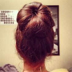 sockbun tutorial!   Cut the toe off of a sock   -step 1- put the hair into a ponytail in the desired position.  -step 2- put your sock on the outside of your ponytail and pull the hair all the way through.    -step 3- start at the end of the pony and roll toward the bottom of your ponytail towards your head and try to stay as smooth as possible.   -step 4- make sure the sock is not visible. fix as desired as well as any finishing touches.   -step 5- party on and enjoy!   By Stephanie Sharp