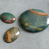 BLOODSTONE - Place over the heart chakra. Strengthens the heart, grounding the heart energy to reduce irritability, aggression and impatience. Meditate or lie on top of to raise the kundalini energy. Regulates blood issues. If polished, do not use water.