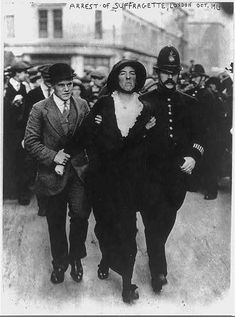 British police arresting a suffragette for protesting in favor of her right to vote in 1913.