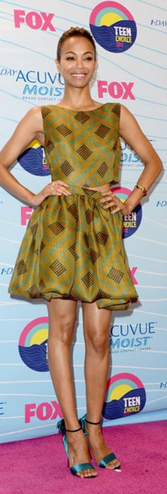 Who made Zoe Saldana's print cropped top, print skirt, blue sandals and gold jewelry that she wore in Universal City for the 2012 Teen Choice Awards? Shoes – Christian Louboutin  Dress – Jonathan Saunders  Jewelry – Tiffany and Co