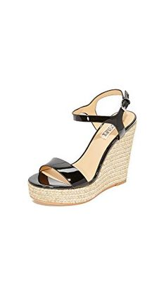 afa31e87c88f Shimmering threads weave through the braided jute trim on these patent  Badgley Mischka wedges. Slim ankle strap with buckle closure.
