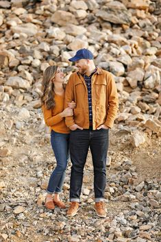Fall Engagement Session - Red Lodge - Montana - Beartooth Pass - Beartooth Highway - Man - Woman - Engaged - Couple - Fiancé - Outdoor - Mountains - Rocks - Brown - Gold - Orange - Sweater - Plaid Shirt - Jacket - Jeans - Blue Baseball Cap - Montana Wedding Photographer - Sara Nagel Photography