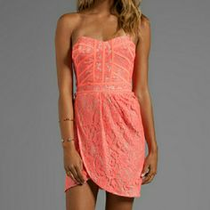 Finders Keepers Neon Coral Lace Somerset Dress NWTs. Zip back closure. Fitted bodice with corset boning. Completely sold out. You can add straps if you like but it does not come with them. Finders Keepers Dresses Mini