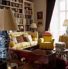 A bookcase stretches the length of one of the living room walls.....pretty colors