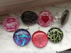 Easy to make your own pendants with glass stones, clear/colored nail polish, E6000 glue and jewelry backs