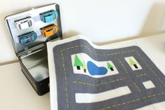 Portable car play kit -- used Velcro to attach the cars inside the lunch box!