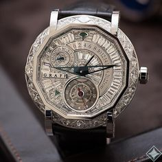 Master of the arts. Master Graff Tourbillon GMT. With a case in platinum fully set with case using 24 bespoke diamonds. Each bespoke diamond is supplied with a GIA certificate and the case, fully set dial, case back and buckle total 22.63 carats. Limited to just 5 pieces world wide.