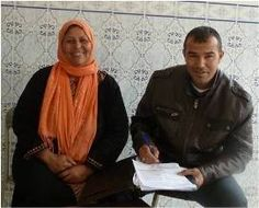 A microcredit client of Tunisia repaying her loan