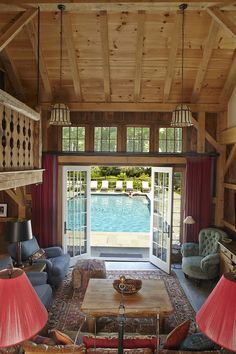 This poolhouse interior looks like a mini house! Love!