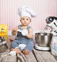 Baby photo in a baker's hat holding baking supplies :).    www.picturethat.ca