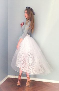 The skirt is made of organza and covered with tulle. Perfectly holds its form and gives playful look. Suitable for wedding, parties, proms and
