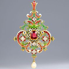 Another beautiful piece that is part of the Taft Museum exhibition (see previous post), is this wonderful neo-renaissance pendant by Lucien Falize, c.1880. Centred on a deep red tourmaline, the elaborate scroll and fretwork pendant is decorated with green, red and white enamel, embellished with diamonds and suspends a pearl. ✨