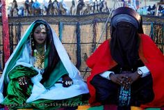 Libyan Tuareg, just married. Fascinating how gender politics plays so differently outside of a Eurocentric world. Here the groom is covered with a 'niqab,' while the bride is decorated with her face showing.