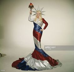 American actress Mae West posing as a striped Statue of Liberty in a publicity still for Mike Sarne's 1970 comedy Myra Breckinridge.