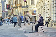 Download Street Artist Playing The Cymbalon Downtown Royalty Free Stock Image for free or as low as 0.68 lei. New users enjoy 60% OFF. 20,205,535 high-resolution stock photos and vector illustrations. Image: 35878526