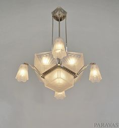 EJG : French 1930 art deco chandelier in nickel plated bronze and brass and moulded pressed glass. (paravas-ebay)