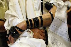 Holocaust survivors celebrate the Bar-Mitzvah's they missed as boys.  Notice his camp tatoo between the straps of his tefilin.