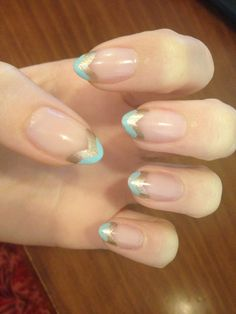 Lana del Rey inspired stiletto nails. Blue and gold chevron nails. Gold tip nails. Variations on a French tip. Almond nail shape.