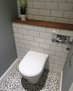 grey flooring Cloakroom Revamp Weekend revamp in our downstairs cloakroom, most satisfying revamp to date! New back to wall toilet, metro tiles and Devonstone grey floor tiles with a complimenting solid oak shelf. Small Downstairs Toilet, Small Toilet Room, Downstairs Cloakroom, Bad Inspiration, Bathroom Inspiration, Bathroom Ideas, Bathroom Layout, Cloakroom Ideas, Grey Floor Tiles Bathroom