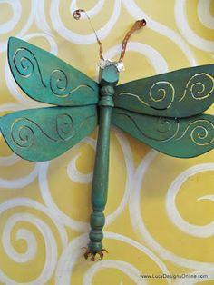 table leg dragonfly keys for eyes, plumbing strap antenna, flower on the tail