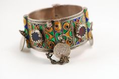 Africa | 1940s Berber bracelet | Silver with cloisonne enamel and red and blue glass beads and 4 Moroccan 1 Dirham AH 1299 silver coins that were minted in Paris between 1873 and 1894.