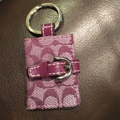 Purple COACH keychain Adorable authentic rare purple COACH keychain. Features belt snap and two plastic slots inside. Perfect for holding small pictures or just a cute addition to keys/purses Coach Accessories