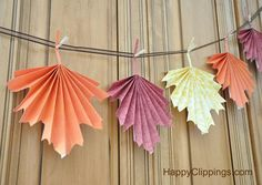 Folded Paper Leaves While you're busy prepping in the kitchen and setting the table, have the little ones create some home decor by this easy project that involves paper crafting a beautiful leaf garland to hang when guests arrive! Autumn Crafts, Autumn Art, Thanksgiving Crafts, Autumn Leaves, Holiday Crafts, Fall Paper Crafts, Diy Autumn, Thanksgiving Table, Craft Projects