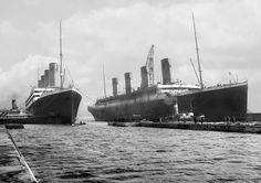 Belfast Northern Ireland 6th march 1912: Titanic (right) being moved out of drydock to allow her sister ship Olympic (left) to replace a damaged propeller blade [1548 x 1090]